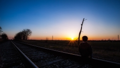 In our little town it seems like we are surrounded by train tracks. This was taken behind our subdivision. It's a favorite spot for my youngest son (in this image) to make movies with his buddies. It's also a great place to watch the end of day.