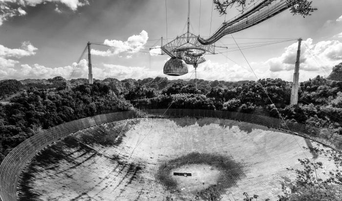 The world's largest and most sensitive radiotelescope is located in Arecibo, Puerto Rico. You can learn about this amazing feat of engineering and science here.